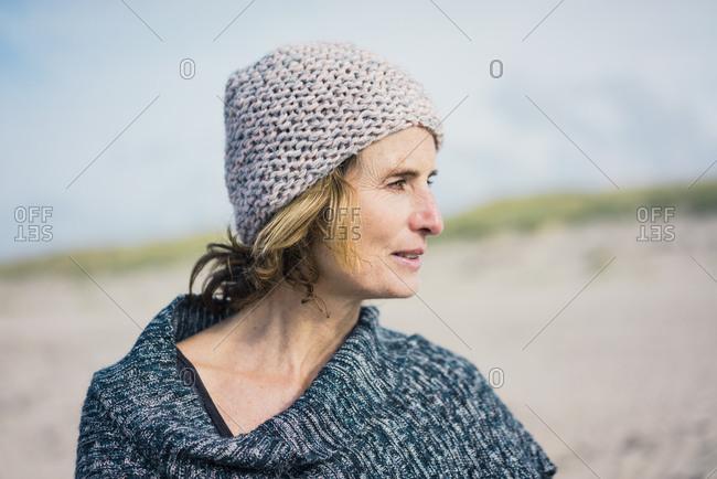 Mature woman- wearing wolly hat- portrait