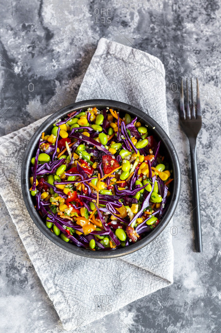 Salad with edamame- maize- red cabbage- carrot- bulgur- tomato- from above