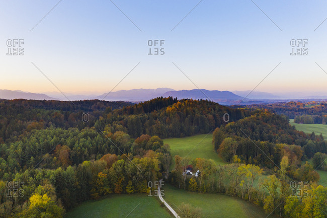Germany- Upper Bavaria- Toelzer Land- Bavarian Prealps- Dietramszell- Zeller Wald- Aerial view of forest in autumn at sunrise