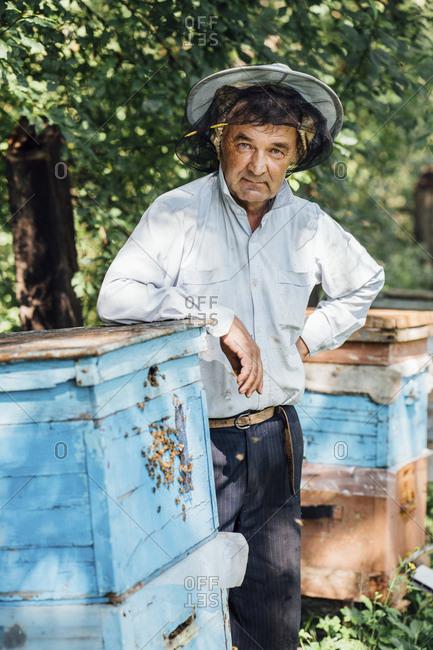 Russland- Portrait of beekeeper at beehive