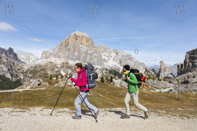 Italy- Cortina d\'Ampezzo- two people hiking in the Dolomites mountain area