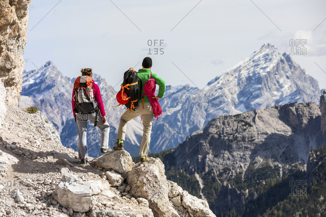 Italy- Cortina d'Ampezzo- couple with rope and climbing equipment looking at view