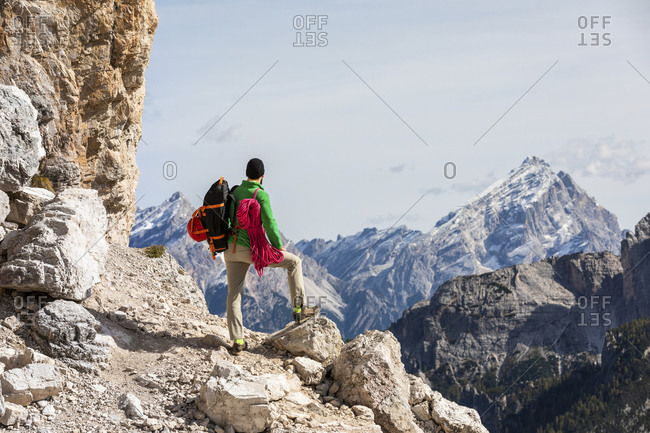 Italy- Cortina d'Ampezzo- man with rope and climbing equipment looking at view