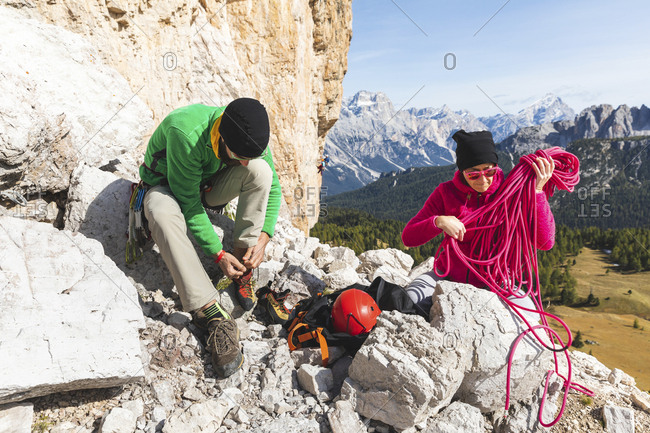 Italy- Cortina d'Ampezzo- couple getting ready for climbing in the Dolomites mountains