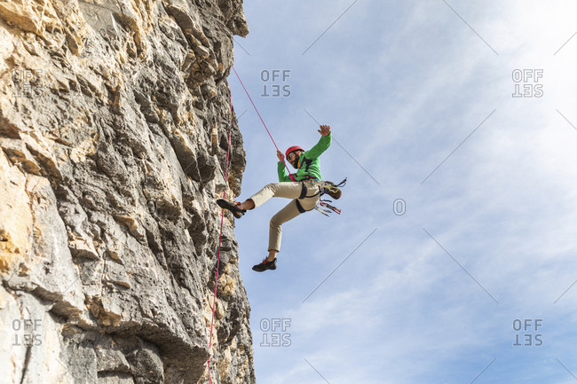 Italy- Cortina d'Ampezzo- man abseiling in the Dolomites mountains