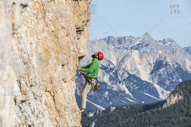 Italy- Cortina d'Ampezzo- man climbing in the Dolomites mountains