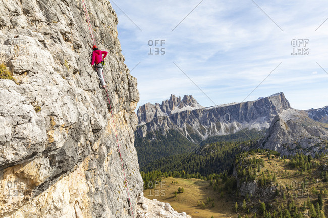 Italy- Cortina d'Ampezzo- woman using chalk poweder while climbing in the Dolomites mountains
