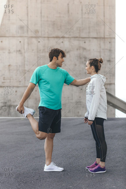 Young couple preparing for a run