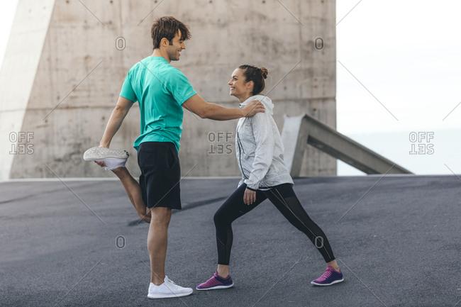 Happy couple preparing for a run
