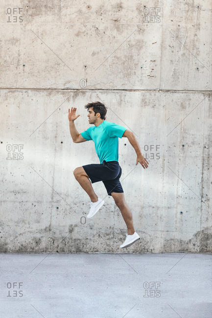 Man running during urban workout