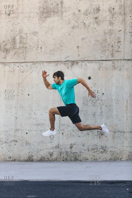 Man running on concrete