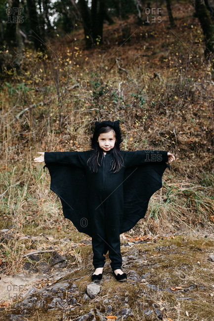 Young girl dressed in a bat Halloween costume