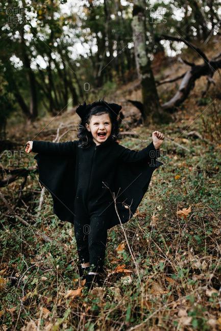 Young girl wearing a bat Halloween costume