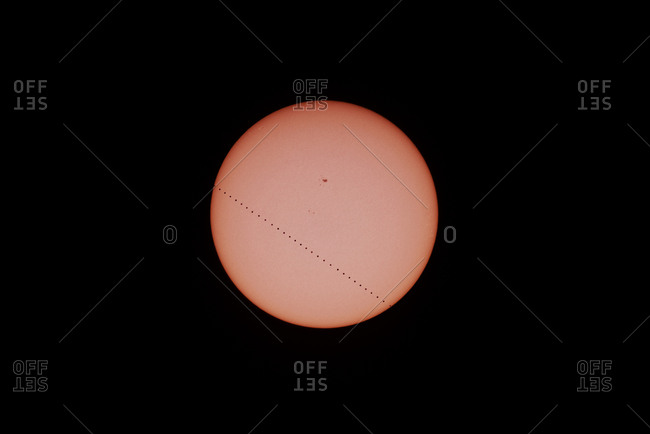 Mercury passes across the disc of the sun. Sunspots are in the upper middle part of the Sun.