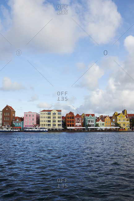 Willemstad, Curacao - October 31, 2018: Historic and colorful waterfront buildings of the Punda district of Willemstad. The Dutch architecture has UNESCO World Heritage Site status.