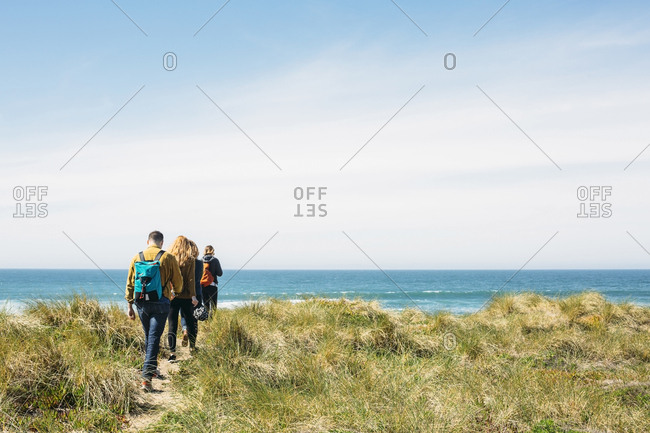 Friends hiking to the beach at Point Reyes, California