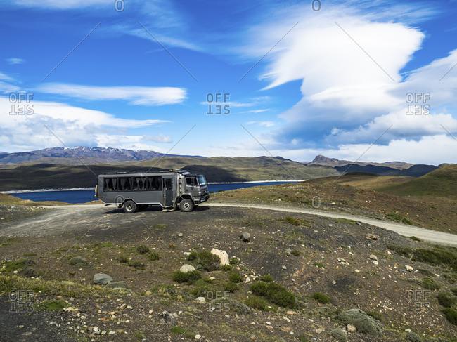 Chile- Patagonia- Torres del Paine National Park- Cerro Paine Grande and  Torres del Paine- Lago Nordenskjold- bus