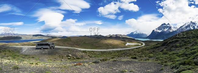 Chile- Patagonia- Torres del Paine National Park- Cerro Paine Grande and  Torres del Paine- Lago Nordenskjold- bus- panoramic view