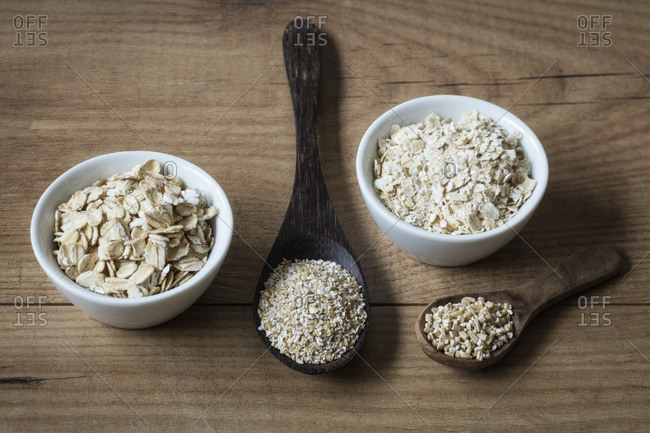 Two variations of oat flakes- oat bran and steel-cut oats