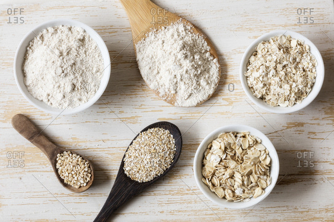 Two variations of oat flakes- oat bran- oatmeal and steel-cut oats