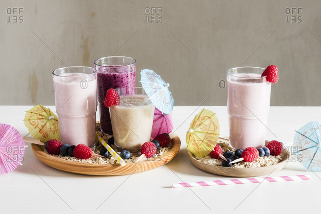 Glasses of berry smoothies with oat flakes