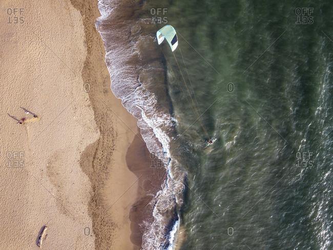 Indonesia- Bali- Berawa beach- Aerial view of kite surfer