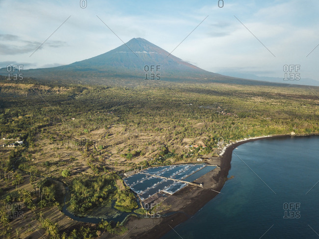 Indonesia- Bali- Amed- Aerial view of shrimp farm and volcano Agung in background