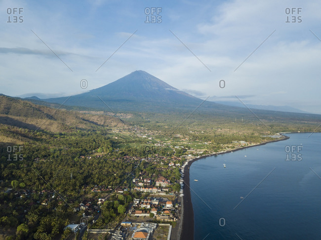 Indonesia- Bali- Amed- Aerial view of Amed beach and volcano Agung