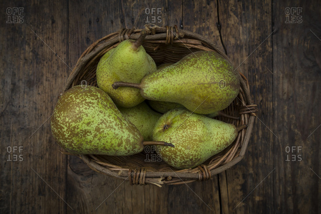 Organic pears 'Conference' in wickerbasket