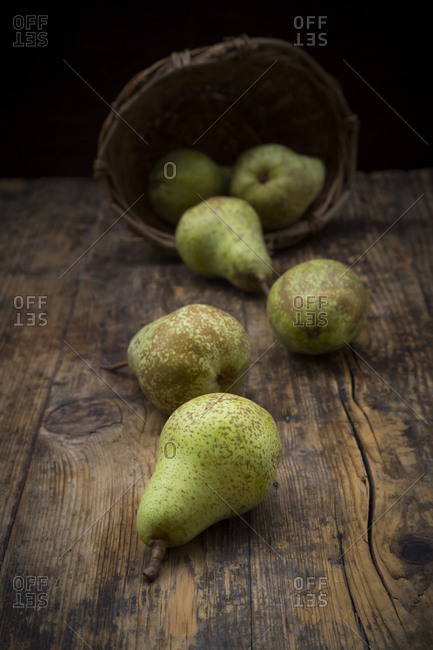 Organic pears 'Conference' on dark wood