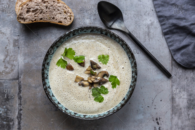 Creme of mushroom soup with cocosnut milk- parsley and baguette