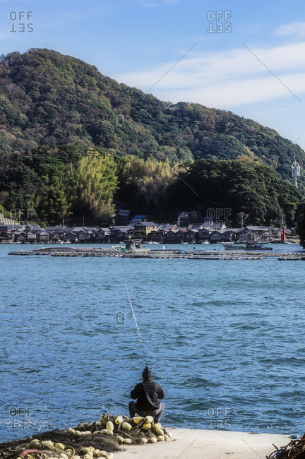Japan- Kyoto Prefecture- fishing village Ine- townscape with angler