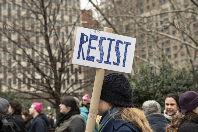 Foley Square - January 19, 2019: Resist sign at the Womens March in Foley Square, in New York City, NY, USA, on January 19th, 2019.
