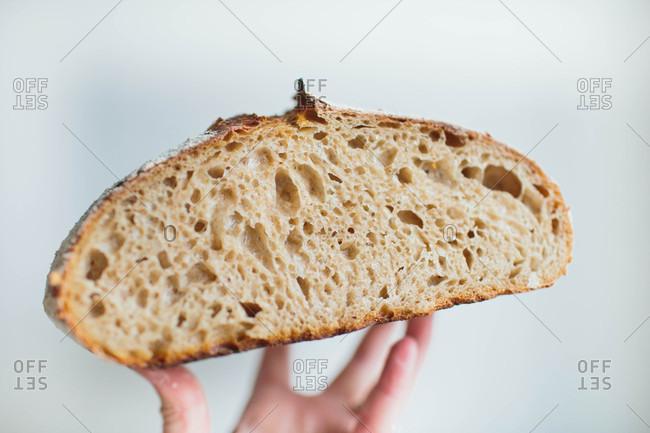 Hand holding sourdough bread