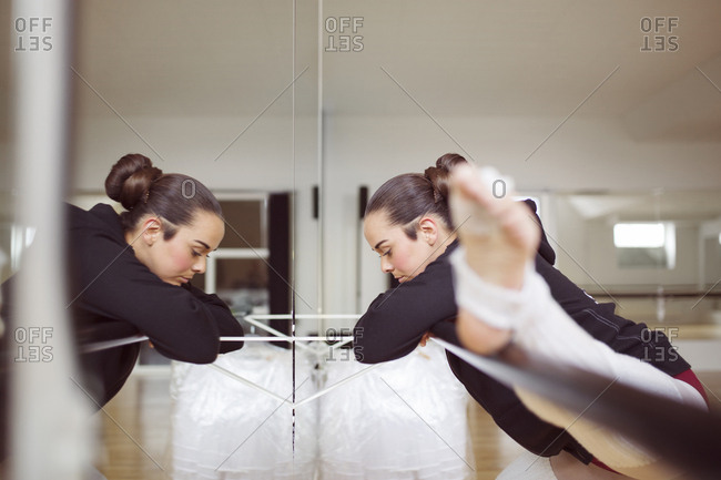 Ballerina stretching on barre