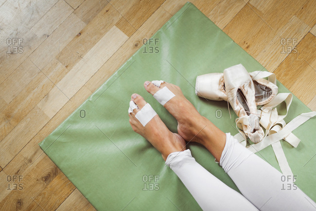 Low section of ballerina on mat