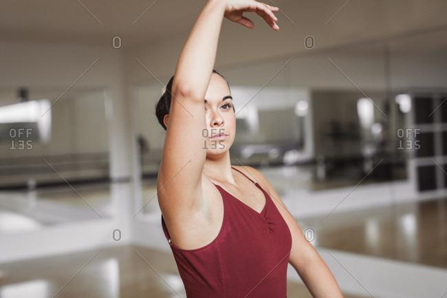Ballerina dancing in studio