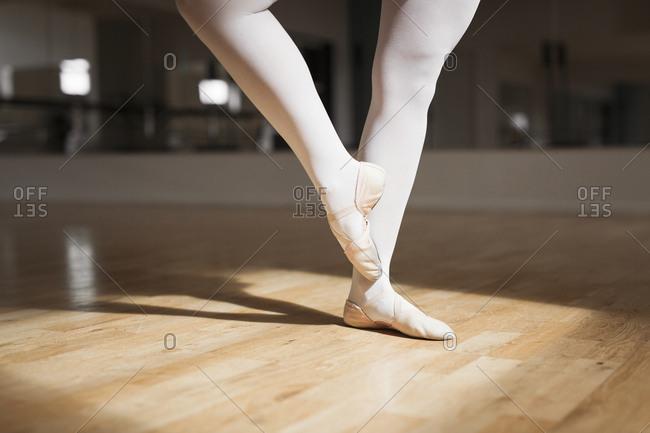 Low section of ballerina dancing