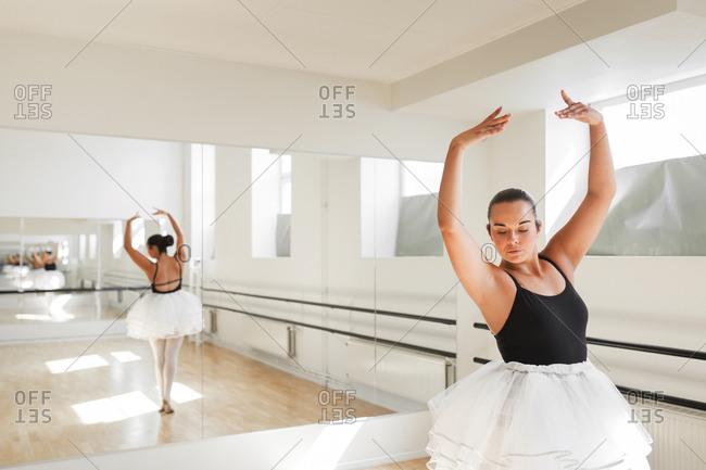 Ballerina dancing in front of mirror