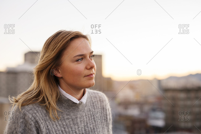 Portrait of young blonde woman in city