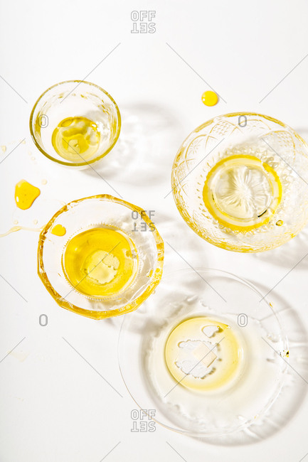 Glasses filled with honey on a white background