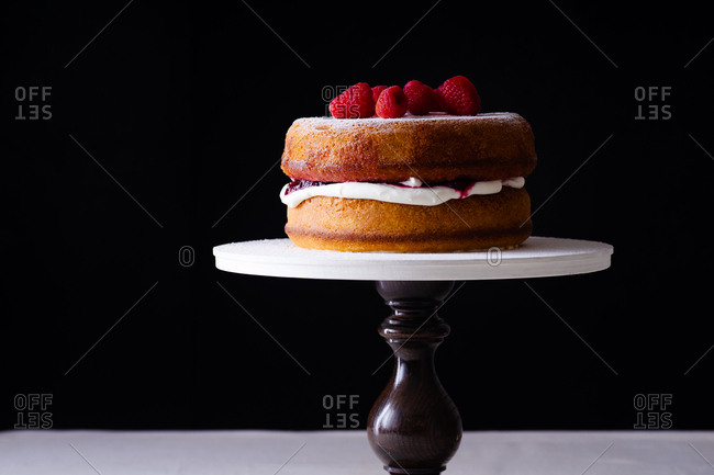 Victoria sponge cake with fresh strawberries on a cakestand