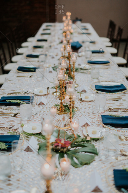 White and blue table setting at a wedding
