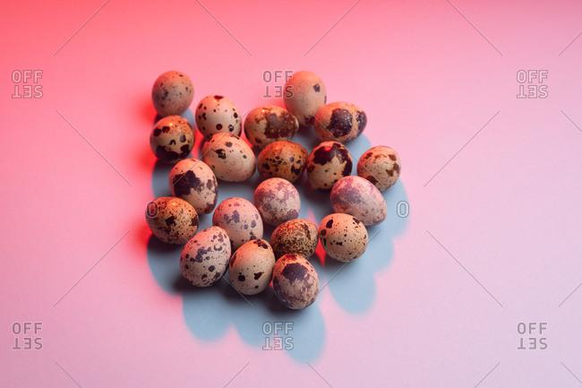 Quail eggs in colorful lighting