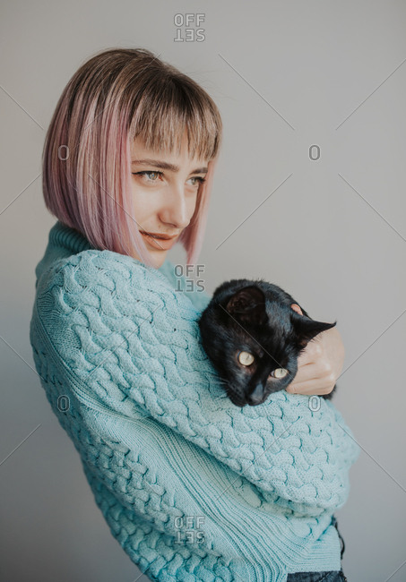 Woman poses with her black cat