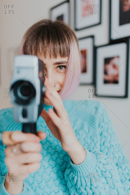 Woman looks through her super 8 camera