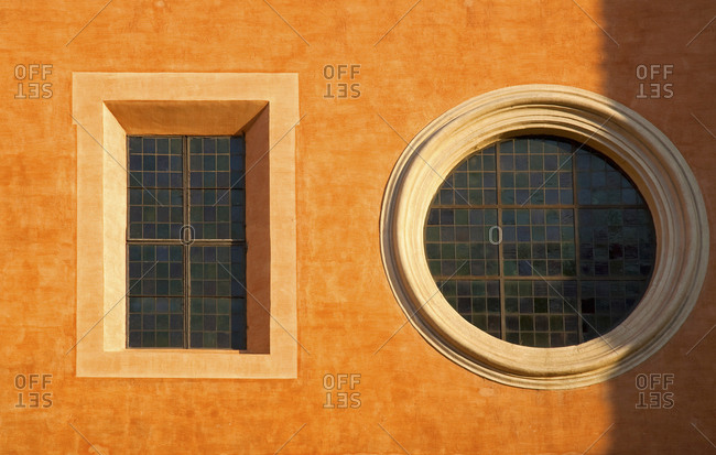 Italy Rome, round and square windows on building  near Vatican area.
