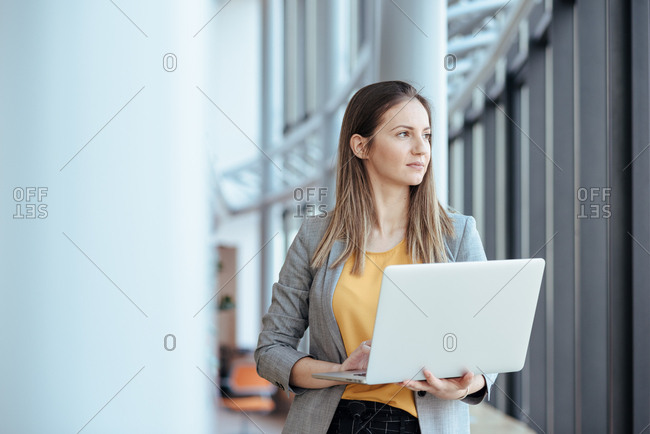 Business woman holding her computer