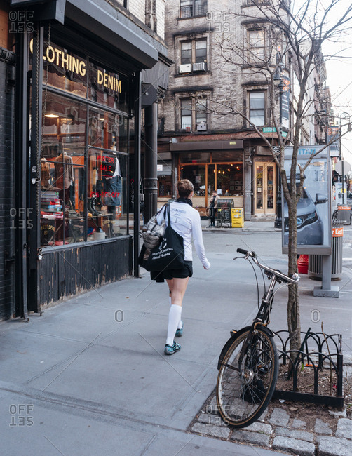 New York, NY - March 26, 2013: girl in skirt walking down manhattan street