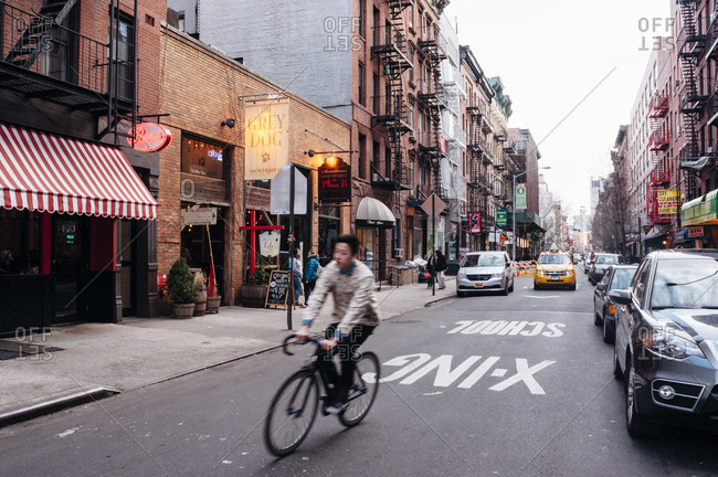 New York, NY - March 26, 2013: Man on bike in downtown manhattan